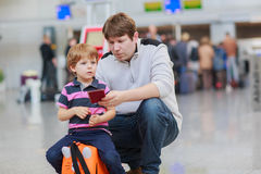 Father and little son at the airport Stock Image