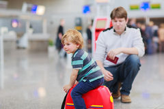 Father and little son at the airport Royalty Free Stock Images