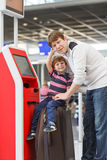 Father and little son at the airport, traveling together Stock Photo