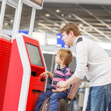 Father and little son at the airport, traveling together Royalty Free Stock Photo