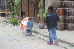 Father and little son walk in Daxu,Guilin, China Stock Photography