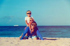Father with little son and daughter play on beach Stock Images