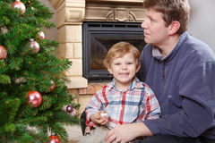 Father and little son decorating christmas tree at home Royalty Free Stock Photo