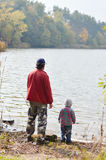Father and little son fishing together on autumn day Stock Photography
