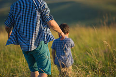 Father and a little son go on a field Royalty Free Stock Photography