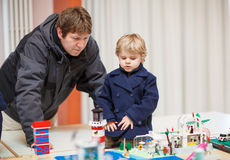 Father and  little son having fun on toy exposition, indoors. Stock Photo