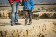 Father and little son hiking boots in mountains Royalty Free Stock Images