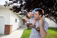Father With Little Son on His Shoulders Royalty Free Stock Image