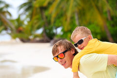 Father and little son hug on summer beach Royalty Free Stock Image
