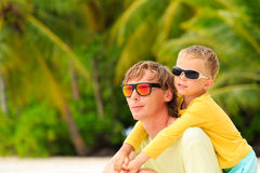 Father and little son hug on summer beach Royalty Free Stock Images