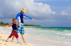 Father and little son learning surfing at summer Royalty Free Stock Photo