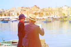Father and little son looking at map, family. Travel in Europe stock photo