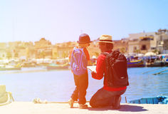 Father and little son looking at map, family. Travel in Europe Stock Photos