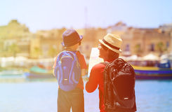 Father and little son looking at map in Malta Royalty Free Stock Photography