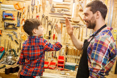 Father and little son making high five at workshop Stock Photography