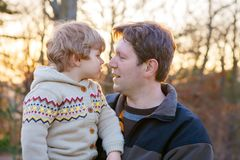Father and little son in park or forest, outdoors. royalty free stock images