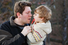 Father and little son in park or forest, outdoors. Royalty Free Stock Photo