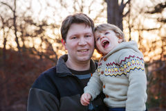 Father and little son in park or forest, outdoors. Royalty Free Stock Image