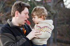 Father and little son in park or forest, outdoors. Royalty Free Stock Photos