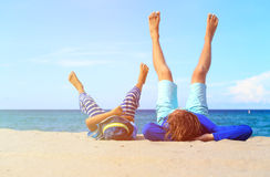 Father and little son play on beach Royalty Free Stock Images