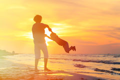 Father and little son play at sunset Royalty Free Stock Images