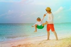 Father and little son play on tropical beach. Vacation Royalty Free Stock Photos