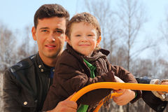 Father and little son at playground Stock Photo