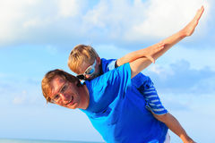 Father and little son playing on blue sky Royalty Free Stock Image