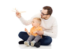 Father and little son playing with toy airplane Stock Photography