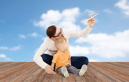 Father and little son playing with toy airplane Stock Image