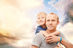 Father with little son portrait on the ky background Royalty Free Stock Photo