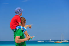 Father and little son on shoulders at summer beach Royalty Free Stock Photo