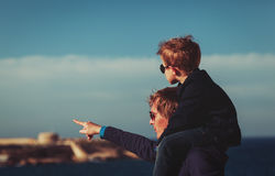Father and little son on shoulders travel in Europe. Family travel - father and little son on shoulders travel in Europe stock photos