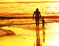 Father and little son silhouettes Royalty Free Stock Photos
