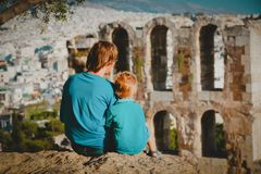 Father and little son travel in Acropolis, Athens, Greece. Looking at ancient buildings stock images