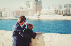 Father and little son travel in the city looking at modern buildings. Family travel-father and little son travel in the city looking at modern buildings stock image