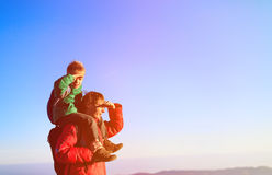 Father and little son travel in mountains Stock Images