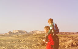 Father and little son travel in mountains Stock Photo