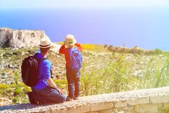Father and little son travel in mountains Royalty Free Stock Images
