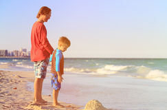 Father and little son walk on the beach Stock Photo