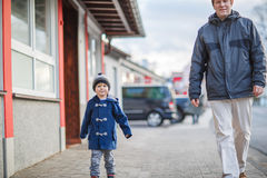 Father and  little son walking on the street in German village Royalty Free Stock Photo