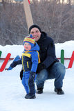 Father and little son in winter park Stock Photos