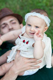 Father lying in a meadow with her daughter Royalty Free Stock Photography