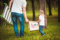 Father making birdhouse with daughter Stock Image