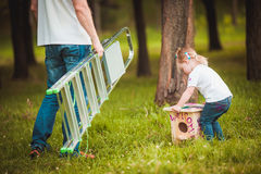 Father making birdhouse with daughter Royalty Free Stock Image