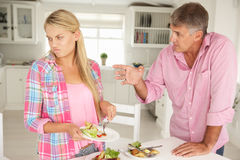 Father Making Teenage Daughter Do Chores Royalty Free Stock Images