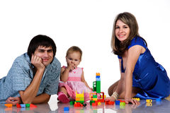 Father, mother and baby playing together stock photo