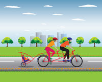 Father and mother biking with little son. Stock Photography