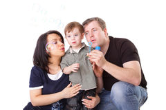 Father, mother and child blow bubbles Stock Photography