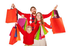 Father, mother and child holding up shopping bags Royalty Free Stock Photography